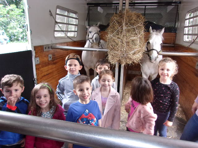 Happy Jewish Preschoolers Meet Horses